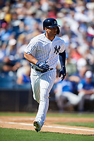 New York Yankees second baseman Gleyber Torres (25) runs to first base during a Grapefruit League Spring Training game against the Toronto Blue Jays on February 25, 2019 at George M. Steinbrenner Field in Tampa, Florida.  Yankees defeated the Blue Jays 3-0.  (Mike Janes/Four Seam Images)
