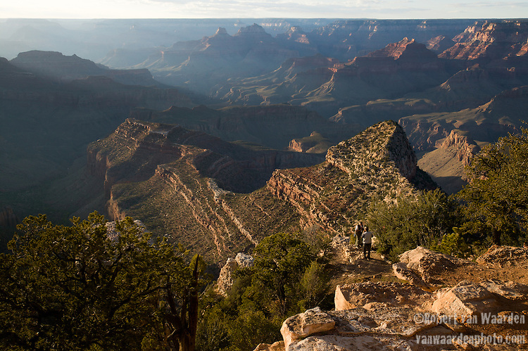 Tourists enjoy the sunset and the Rocky outcrops on the Grand Canyon in Arizona, United States of America.