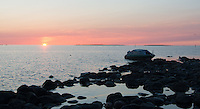 The sun sets on this summer night as I reach the rocky shores of the Norrskär group of Islands in the middle of the Giulf of Bothnia, about 25 miles from the coast of Finland. I beach the boat on the rocks and begin to photograph throughout the white night and the following day.