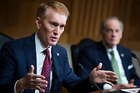 """United States Senator James Lankford (Republican of Oklahoma), directs a question to Mark A. Morgan, acting commissioner of the U.S. Customs and Border Protection, during the US Senate Homeland Security and Governmental Affairs Committee hearing titled """"CBP Oversight: Examining the Evolving Challenges Facing the Agency,"""" in Dirksen Senate Office Building on Thursday, June 25, 2020. United States Senator Tom Carper (Democrat of Delaware), appears at right. <br /> Credit: Tom Williams / Pool via CNP/AdMedia"""