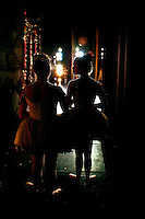 Two young dancers wait for their cue to perform during the North Carolina Dance production of the Nutcracker at Belk Theatre in Charlotte, NC.