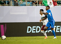CHARLOTTE, NC - JUNE 23: Samuel Camille #18 and Uriel Antuna #22 run to the ball during a game between Mexico and Martinique at Bank of America Stadium on June 23, 2019 in Charlotte, North Carolina.