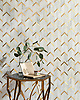 Belen, a hand-cut stone mosaic, shown in polished Calacatta Gold and brass brushed, is part of the Bright Young Things™ collection by New Ravenna.