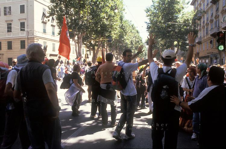 genova luglio 2001, proteste contro il g8. manifestanti alzano le mani dopo una carica della polizia --- genoa july 2001, protests against g8 summit. demonstrators raise hands after a charge of the police