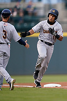 Heriberto Hernandez (11) of the Charleston RiverDogs slaps hands with manager Blake Butera (3) after hitting a solo home run in a game against the Columbia Fireflies on Tuesday, May 11, 2021, at Segra Park in Columbia, South Carolina. (Tom Priddy/Four Seam Images)