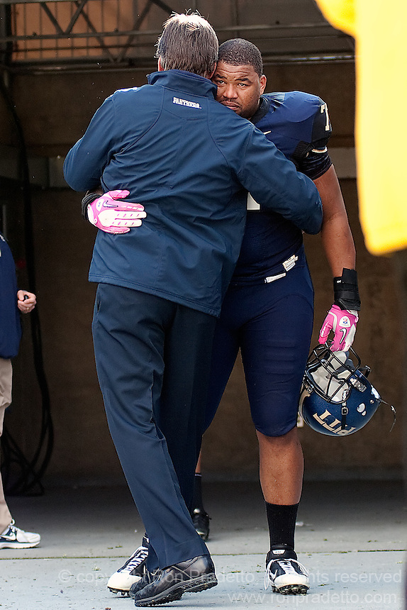 Pitt offensive tackle Jason Pinkston is greeted by head coach Dave Wannstedt on Senior Day. The WVU Mountaineers defeated the Pitt Panthers 35-10 at Heinz Field, Pittsburgh, Pennsylvania on November 26, 2010.