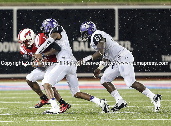 Southern Methodist Mustangs wide receiver Der'rikk Thompson (7), TCU Horned Frogs safety Chris Hackett (1) and TCU Horned Frogs linebacker Kenny Cain (51) in action during heavy rainfall in the game between the Southern Methodist Mustangs and the TCU Horned Frogs at the Gerald J. Ford Stadium in Dallas, Texas. TCU defeats SMU 24 to 16..