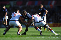 Ross Ford of Scotland is tackled by Titi Lamositele and Greg Peterson of USA during Match 18 of the Rugby World Cup 2015 between Scotland and USA - 27/09/2015 - Elland Road, Leeds<br /> Mandatory Credit: Rob Munro/Stewart Communications