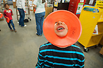 Alex Wells goofs off during the Mini Golf Night at the Carson City Library on Friday May 9, 2014. Kids and parents built a custom mini golf course throughout the library using anything at their disposal and engineering ideas to make a difficult course. Everything from tables to shelves were used to create creative courses.<br /> (Photo by Kevin Clifford/Nevada Photo Source)