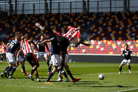 17th April 2021; Brentford Community Stadium, London, England; English Football League Championship Football, Brentford FC versus Millwall; Ethan Pinnock of Brentford heads the ball away from a corner