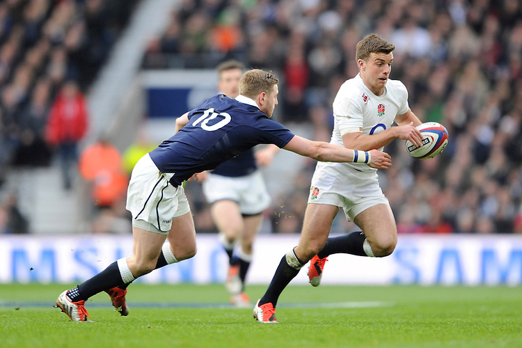 George Ford of England goes around Finn Russell of Scotland