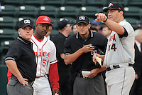 First-year manager Billy McMillon (51) of the Greenville Drive, second from left, discusses ground rules with the umpires and Delmarva manager Ryan Minor (44), right, prior to a game against the Delmarva Shorebirds on Opening Day, April 8, 2010, at Fluor Field at the West End in Greenville, S.C. Photo by: Tom Priddy/Four Seam Images