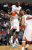 Dec. 20, 2010; Charlottesville, VA, USA; Virginia Cavaliers center Assane Sene (5) grabs a rebound during the game against the Norfolk State Spartans at the John Paul Jones Arena. Mandatory Credit: Andrew Shurtleff