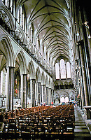 Salisbury Cathedral: tall and narrow nave. It has three levels: a tall pointed arcade, an open gallery and a small clerestory. Gothic architecture.