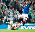 ::  CELTIC'S SCOTT BROWN IS FOULED BY RANGERS' NIKICA JELAVIC ::