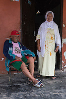 Borobudur, Java, Indonesia.  Elderly Couple in front of their House in a Rural Village.