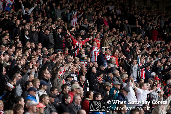 Sheffield United 2 Leeds United 0, 19/03/2011. Bramall Lane, Championship. Sheffield United supporters in the Kop Stand celebrating the second goal of the game, scored by substitute Bjorn Helge Riise during the second half of the Npower Championship fixture with Leeds United. The home team won the game by two goals to nil watched by a crowd of 23,728. Bramall Lane is the world's oldest professional football ground and at one time hosted both football and cricket. Photo by Colin McPherson.