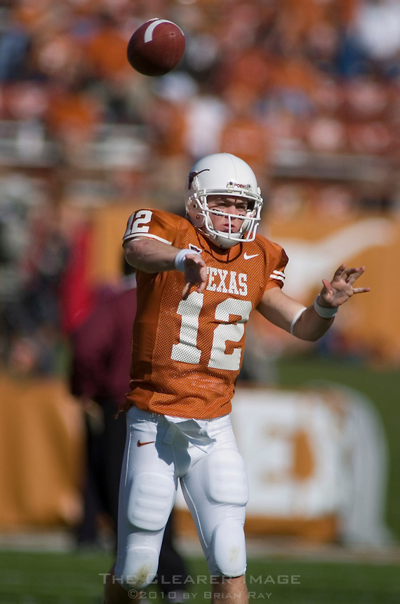 24 November 2006: Texas quarterback Colt McCoy (#12) passes the ball during warmups before the Longhorns 12-7 loss to the Texas A&M University Aggies at Darrell K Royal Memorial Field in Austin, TX.