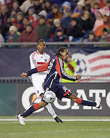 Chicago Fire midfielder Mike Banner (18) crosses as New England Revolution defender Kevin Alston (30) defends. The New England Revolution tied the Chicago Fire, 0-0, at Gillette Stadium on October 17, 2009.