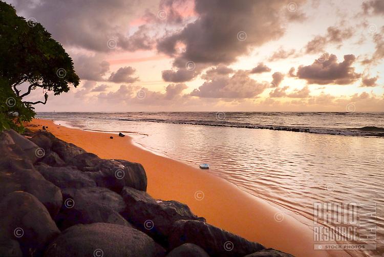 """Sunrise at """"Baby Beach"""" in Kap'aa, Kaua'i."""