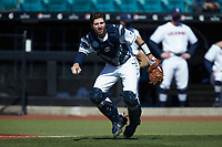 Connecticut Huskies catcher Pat Winkel (43) on defense against the Miami Redhawks at Springs Brooks Stadium on March 5, 2021 in Conway, South Carolina. The Huskies defeated the Redhawks 5-0. (Brian Westerholt/Four Seam Images)