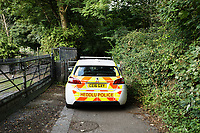 Pictured: Police at a footpath leading to river Ogmore in Sarn near Bridgend, Wales, UK. Monday 02 August 2021 <br /> Re: South Wales Police can confirm that  three people have been arrested following reports of concerns for a missing 5 year old boy, named as Logan Williamson or Logan Mwangi, in Sarn, Bridgend, and the subsequent finding of the body in the Ogmore River near Pandy Park, Bridgend, Wales, UK.<br /> A 39 year male, 30 year female and 13 year old male, all from the Bridgend area, have been arrested on suspicion of murder and are currently in police custody.  We are not looking for anyone else in relation to this incident.