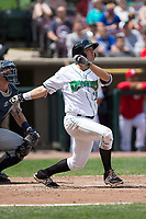Bruce Yari (24) of the Dayton Dragons follows through on his swing against the West Michigan Whitecaps at Fifth Third Field on May 29, 2017 in Dayton, Ohio.  The Dragons defeated the Whitecaps 4-2.  (Brian Westerholt/Four Seam Images)