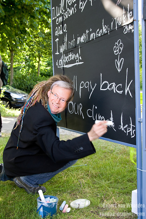 Young Friends of the Earth Europe demonstrate in front of the Maritim Hotel, site of the United Nations Climate Talks in Bonn Germany. The creative action was a classroom of world leaders that have failed to do their homework and and were forced to write the their lines on the board.  (©Robert vanWaarden)