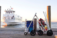Two baskets full of weekend provisions await their ferry on the dock of Fair Harbor, a town on Fire Island, on October 8, 2010.