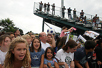 US fans wait at the conclusion of the match to get autographs from Abby Wambach (not pictured) and other USWNT members. The U.S. Women's National Team defeated Canada 1-0 in a friendly match at Marina Auto Stadium in Rochester, NY on July 19, 2009. Abby Wambach of the USWNT scored her 100th career goal in the second half..