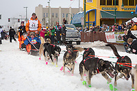 Jake Berkowitz and team leave the ceremonial start line at 4th Avenue and D street in downtown Anchorage during the 2013 Iditarod race. Photo by Jim R. Kohl/IditarodPhotos.com