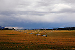 A summer thunder storm approachess this pastoral scene of irrigation and hay farm, Bitterroot Valley, Montana.  Image is south of the hamlet of Stanleyville and north of fabulous Hamilton.  Each south of Missoula.  On the west (left) are the Bitterroot Mountains and to the east the Saphire Mountains.  Lewis and Clark came through this valley.