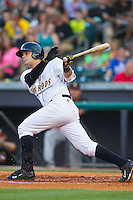Oscar Hernandez (28) of the Bowling Green Hot Rods follows through on his swing against the Quad Cities River Bandits at Bowling Green Ballpark on July 26, 2014 in Bowling Green, Kentucky.  The River Bandits defeated the Hot Rods 9-2.  (Brian Westerholt/Four Seam Images)