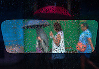 Street photography Cebu city and Mactan island, Philippines Shooting through the Taxi window on a rainy day.