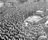 Lt. Col. Woran, Chaplain of the 10th Mountain Div., leads a group of men in prayer at Torboli the day following the unconditional surrender of all German troops in Italy.  May 3, 1945.  Bull.  (Army)<br /> NARA FILE #:  111-SC-205602<br /> WAR & CONFLICT BOOK #:  1034