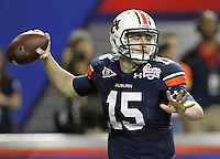 ATLANTA, GA - DECEMBER 31: Clint Moseley #15 of the Auburn Tigers handles the ball during the 2011 Chick Fil-A Bowl against the Virginia Cavaliers at the Georgia Dome on December 31, 2011 in Atlanta, Georgia. Auburn defeated Virginia 43-24. (Photo by Andrew Shurtleff/Getty Images) *** Local Caption *** Clint Moseley