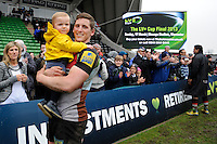 20130309 Copyright onEdition 2013©.Free for editorial use image, please credit: onEdition..Double try scorer Tom Williams of Harlequins celebrates with his son after winning the LV= Cup semi final match between Harlequins and Bath Rugby at The Twickenham Stoop on Saturday 9th March 2013 (Photo by Rob Munro)..For press contacts contact: Sam Feasey at brandRapport on M: +44 (0)7717 757114 E: SFeasey@brand-rapport.com..If you require a higher resolution image or you have any other onEdition photographic enquiries, please contact onEdition on 0845 900 2 900 or email info@onEdition.com.This image is copyright onEdition 2013©..This image has been supplied by onEdition and must be credited onEdition. The author is asserting his full Moral rights in relation to the publication of this image. Rights for onward transmission of any image or file is not granted or implied. Changing or deleting Copyright information is illegal as specified in the Copyright, Design and Patents Act 1988. If you are in any way unsure of your right to publish this image please contact onEdition on 0845 900 2 900 or email info@onEdition.com