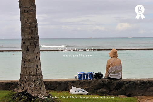 Woman with picnic set looking at ocean (Licence this image exclusively with Getty: http://www.gettyimages.com/detail/85071204 )
