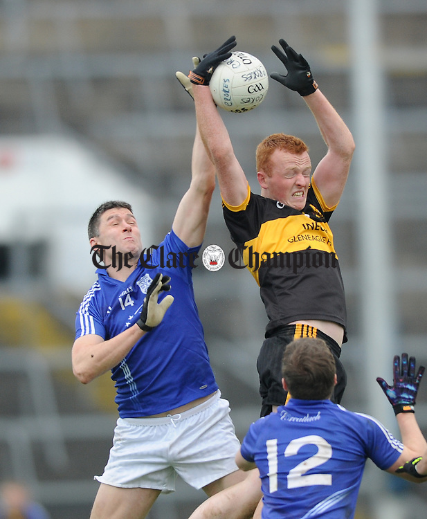 Fergal Lynch of Cratloe in action against Johnny Buckley of Dr. Crokes during their Munster club football final at The Gaelic Grounds. Photograph by John Kelly.
