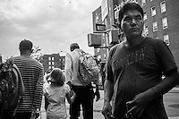"Parents pick up their sons up from school. Middle class families are breaking in the intensely diversified social pattern of Jackson Heights in a sort of ""counter white flight"". Queens, New York City."
