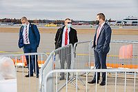 Men in suits stand near crowd control barriers at a Make America Great Again Victory Rally in the final week before the Nov. 3 election at Pro Star Aviation in Londonderry, New Hampshire, on Sun., Oct. 25, 2020.