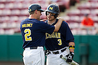 Michigan Wolverines first baseman Coley Crank #3 talks with Rich Maloney #2 during a game against the Seton Hall Pirates at the Big Ten/Big East Challenge at Al Lang Stadium on February 18, 2012 in St. Petersburg, Florida.  (Mike Janes/Four Seam Images)