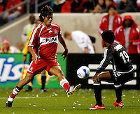 Chicago Fire defender Wilman Conde (22) clears the ball in front of DC United midfielder Clyde Simms (19). The Chicago Fire defeated D. C. United 1-0 during the first leg of the MLS Eastern Conference Semifinal Series at Toyota Park in Bridgeview, IL, on October 25, 2007.