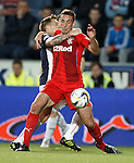 Alan Maybury gets Lee Wallace in a stranglehold