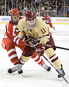 Patrick MacGregor (BU - 4), Pat Mullane (BC - 11) - The Boston College Eagles defeated the Boston University Terriers 3-2 (OT) to win the 2012 Beanpot championship on Monday, February 13, 2012, at TD Garden in Boston, Massachusetts.