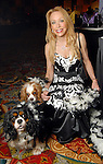 Carolyn St. Clair with Tallulah and Spencer at the 23rd Annual Celebrity Paws Gala benefitting Citizens for Animal Protection's Shelter and Pet Adoption Center at the Hilton Americas Hotel Saturday Nov. 21,2009. (Dave Rossman/For the Chronicle)