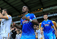 Siriki Dembele of Grimsby Town arriving onto the pitch during the Sky Bet League 2 match between Port Vale and Grimsby Town at Vale Park, Burslem, England on 7 October 2017. Photo by Leila Coker.