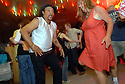 A couple dances at the Mid-City Rock 'n Bowl to Zydeco music in New Orleans, Thursday, April 26, 2007..Zydeco