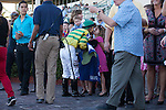 Javier Castellano gets a kiss in the winners circle after winning the Davona Dale(G2) at Gulfstream Park, Hallandale Beach Florida. 02-22-2014