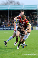 20130216 Copyright onEdition 2013©.Free for editorial use image, please credit: onEdition..David Strettle of Saracens is tackled by Phil Dollman of Exeter Chiefs during the Premiership Rugby match between Saracens and Exeter Chiefs at Allianz Park on Saturday 16th February 2013 (Photo by Rob Munro)..For press contacts contact: Sam Feasey at brandRapport on M: +44 (0)7717 757114 E: SFeasey@brand-rapport.com..If you require a higher resolution image or you have any other onEdition photographic enquiries, please contact onEdition on 0845 900 2 900 or email info@onEdition.com.This image is copyright onEdition 2013©..This image has been supplied by onEdition and must be credited onEdition. The author is asserting his full Moral rights in relation to the publication of this image. Rights for onward transmission of any image or file is not granted or implied. Changing or deleting Copyright information is illegal as specified in the Copyright, Design and Patents Act 1988. If you are in any way unsure of your right to publish this image please contact onEdition on 0845 900 2 900 or email info@onEdition.com